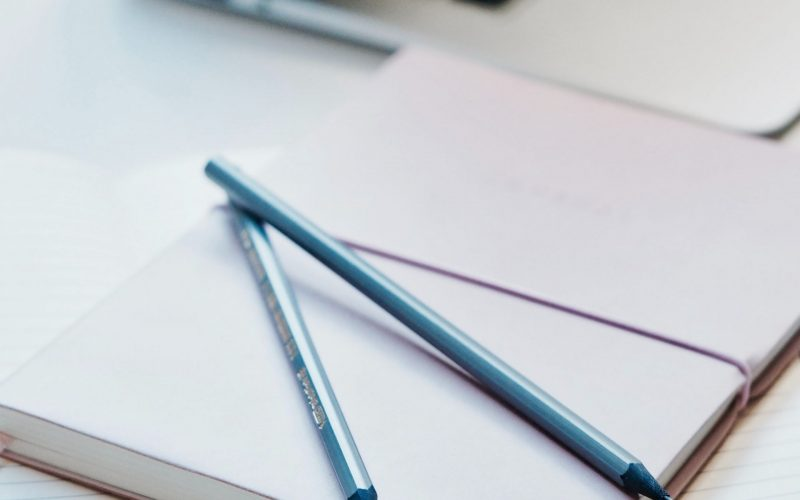 two-blue-pencil-on-top-of-white-notebook-730706